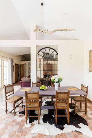 dining table and chairs: Spaceful dining room area with wooden table and chairs, asymetrical carpet and patio entry