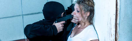 defenceless: Dangerous man is aggressive against young woman Stock Photo