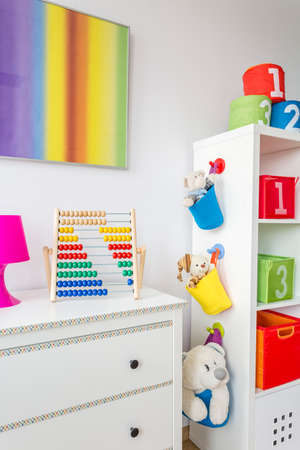 soft toys: Room corner with white commode, rack and soft toys