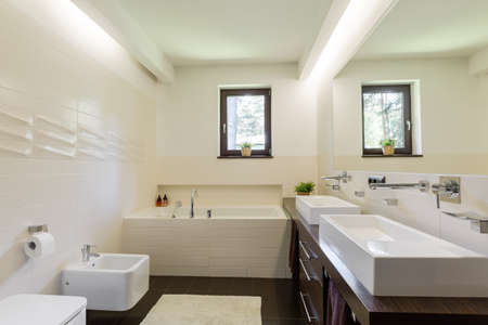 Modern bathroom in brown and vanilla with tiles of interesting texture