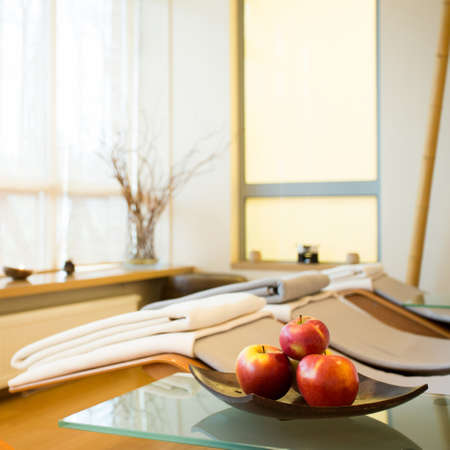 beauty center: Apple on a plate in luxury spa room