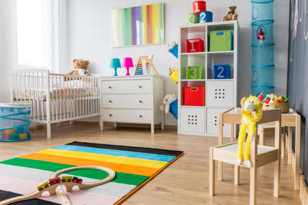 baby toys: Spacious baby room with minimalistic furniture, toys and colorful decorations