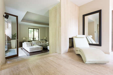 chaise longue: Bright chaise longue in a travertine interior of a luxurious villa