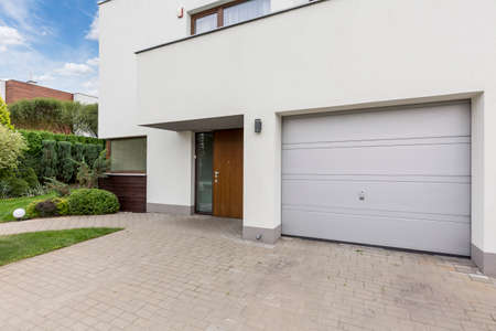 front house: Modern front house entrance with one car garage