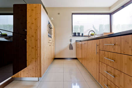 contemporary kitchen: Narrow exclusive wooden kitchen idea in contemporary house