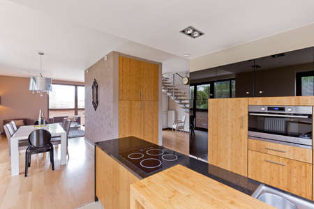 fitted: Wood in fitted contemporary kitchen design- trendy interior Stock Photo