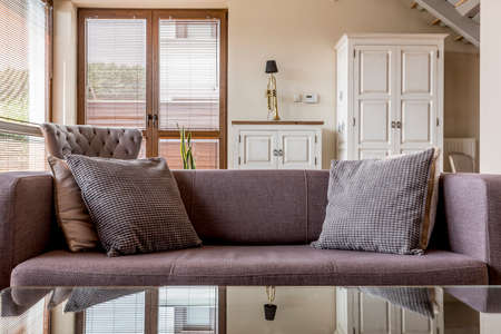 cosy: Cosy couch with pillows in comfortable living room