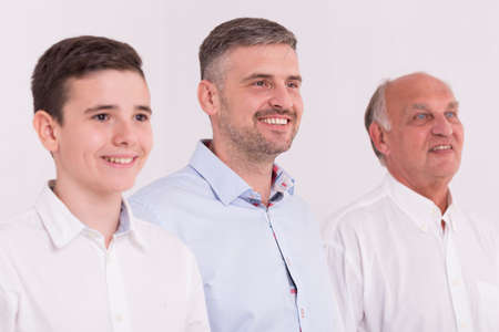 grandkid: Cropped shot of three men smiling and looking in the distance