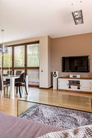 open plan: Tv on the wall in spacious open plan living room
