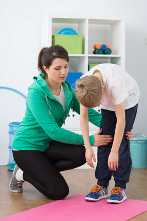posture correction: Shot of a young physiotherapist working with her small patient Stock Photo