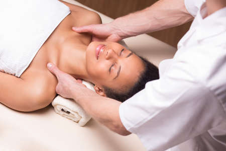 deeply: Close-up of a deeply relaxed woman having a massage