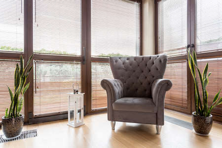 huge: Stylish retro furniture- big grey trendy quilted armchair Stock Photo