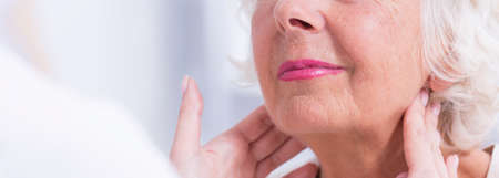lymph: Cropped picture of a doctor checking her patients lymph nodes