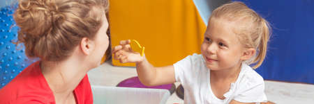 sensory: Disabled girl and her theapist during sensory integration classes