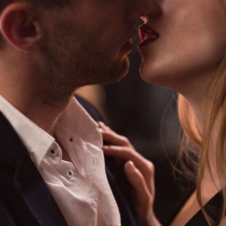 Close-up of elegant beautiful couple kissing passionately
