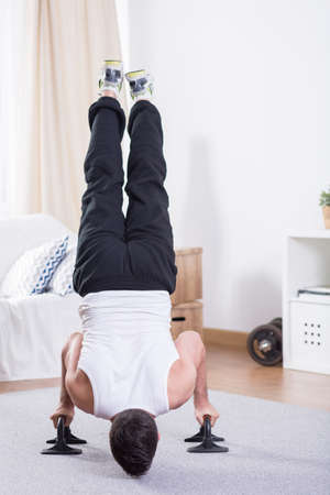 exhaustive: Fit and young guy having an exhaustive training at home
