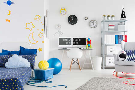 moon chair: Shot of a young boy fully furnished room with cosmic themes on the wall