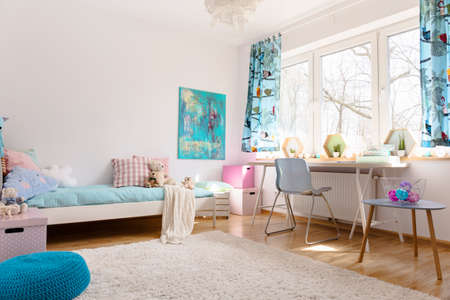 pouf: Teenager room with a space for relax and learn. The room has a big window