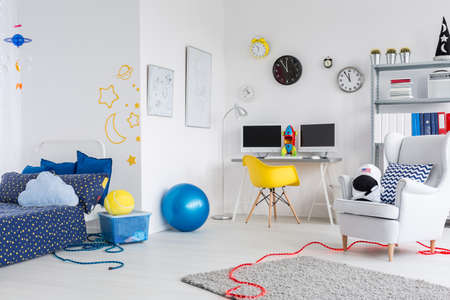 boy bedroom: Shot of a fully furnished room for a young boy with cosmic themes on the wall
