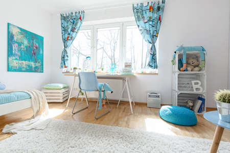lightsome: Comfortable and cozy child room with a bed, desk, chair and big window