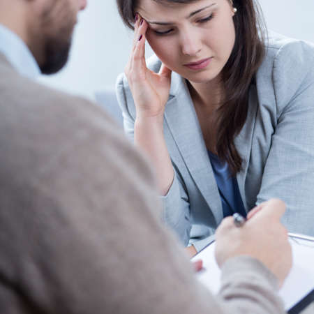 Vertical view of despair woman receiving psychotherapy Stock Photo