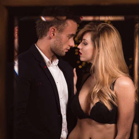 half naked: Image of a half naked female seducing a handsome man