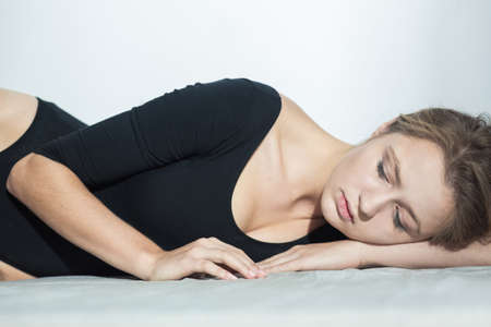 woman lying: Young blonde woman lying on the floor with closed eyes