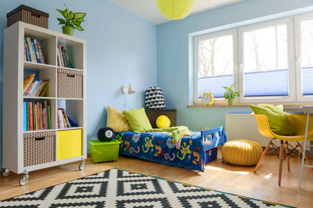 lightsome: Child room with a bookstand, bed, chair, pouf and big window