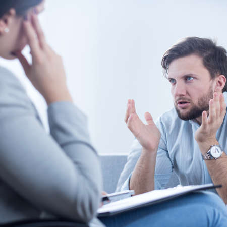 psychiatrist: Angry man talking with psychiatrist or psychologist