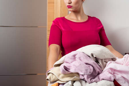 pedant: Well dressed woman keeping the linen basket with towels Stock Photo