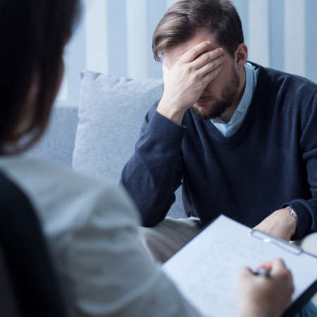 psychologists: Image of despair man at psychologists office