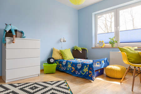 lightsome: Pastel child room with a chest of drawer, bed, pouf and big window