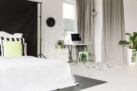 open floor plan: Black and white open floor plan flat with bedroom and office area Stock Photo