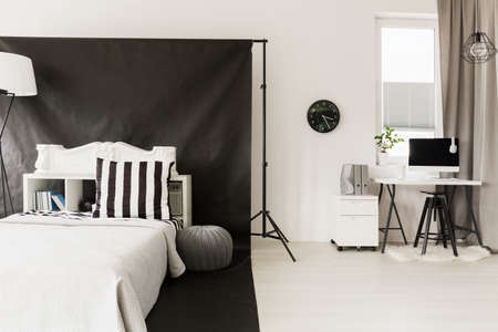 home office interior: Home interior in black and white with sleeping and office space Stock Photo