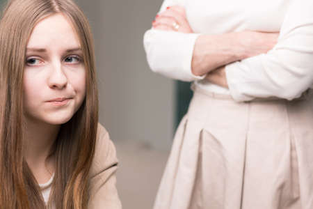 hangup: Teenager not willing to look at the woman with folded arms