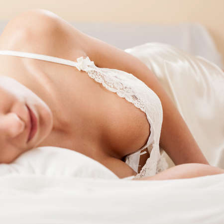 erotic dress: Close-up of a woman sleeping in sexy nightwear
