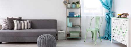 living room sofa: Bright salon with minimalistic design and modern furniture Stock Photo