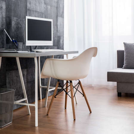 Home Office With Flooring, Desk, Chair, Computer And Decorative Wallpaper.  Stock Photo