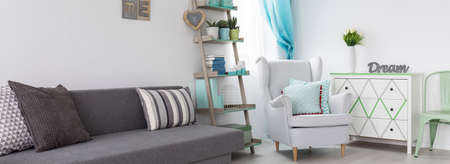 cosy: Cosy room area with comfortable couch, armchairand white commode Stock Photo