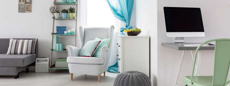 cosy: Living room interior with home office area and cosy armchair