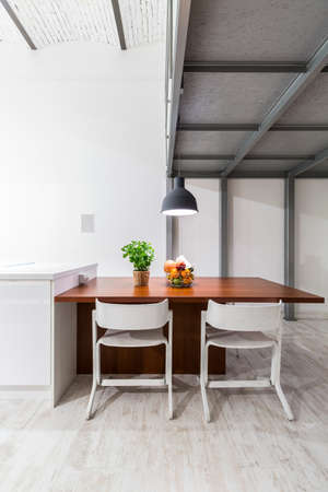 entresol: Shot of a table with two chairs in a modern apartment