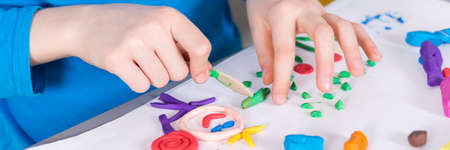 Great and creative fun with modeling clay Imagens