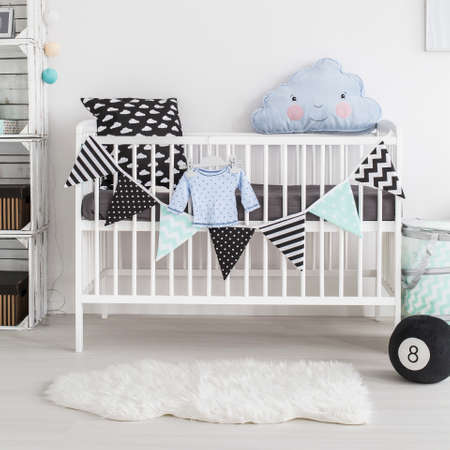 Shot of a crib in a scandinavian style baby room