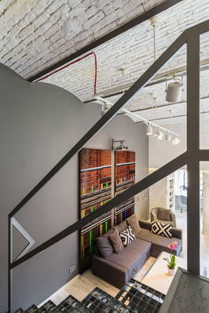 entresol: Shot of a staircase and a living room in a modern apartment Stock Photo