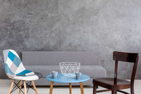 ascetic: Ascetic coffee corner of a modern room, with blue coffee table and two designer chairs