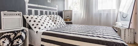 cosy: Ideas for simple bedroom with double cosy bed Stock Photo