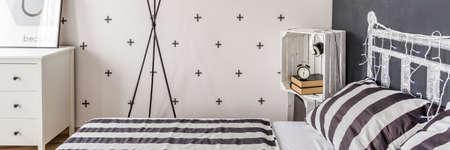 modern interior: Decorative black and white wallpaper in little bedroom