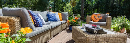 garden furniture: Stylish garden furniture with colorful pillows standing in the hause patio Stock Photo