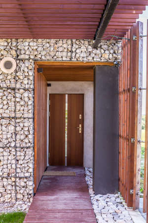 stony: Modern creative house architecture- stony and wooden house entrance Stock Photo