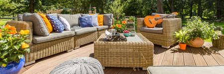 Veranda with garden furniture and plants in flower pots